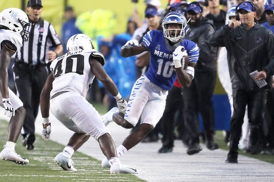 Memphis' Damonte Coxie jukes out of bounds in the final seconds of their game against UCF at the Liberty Bowl in Memphis, Tenn., Saturday, October 13, 2018.