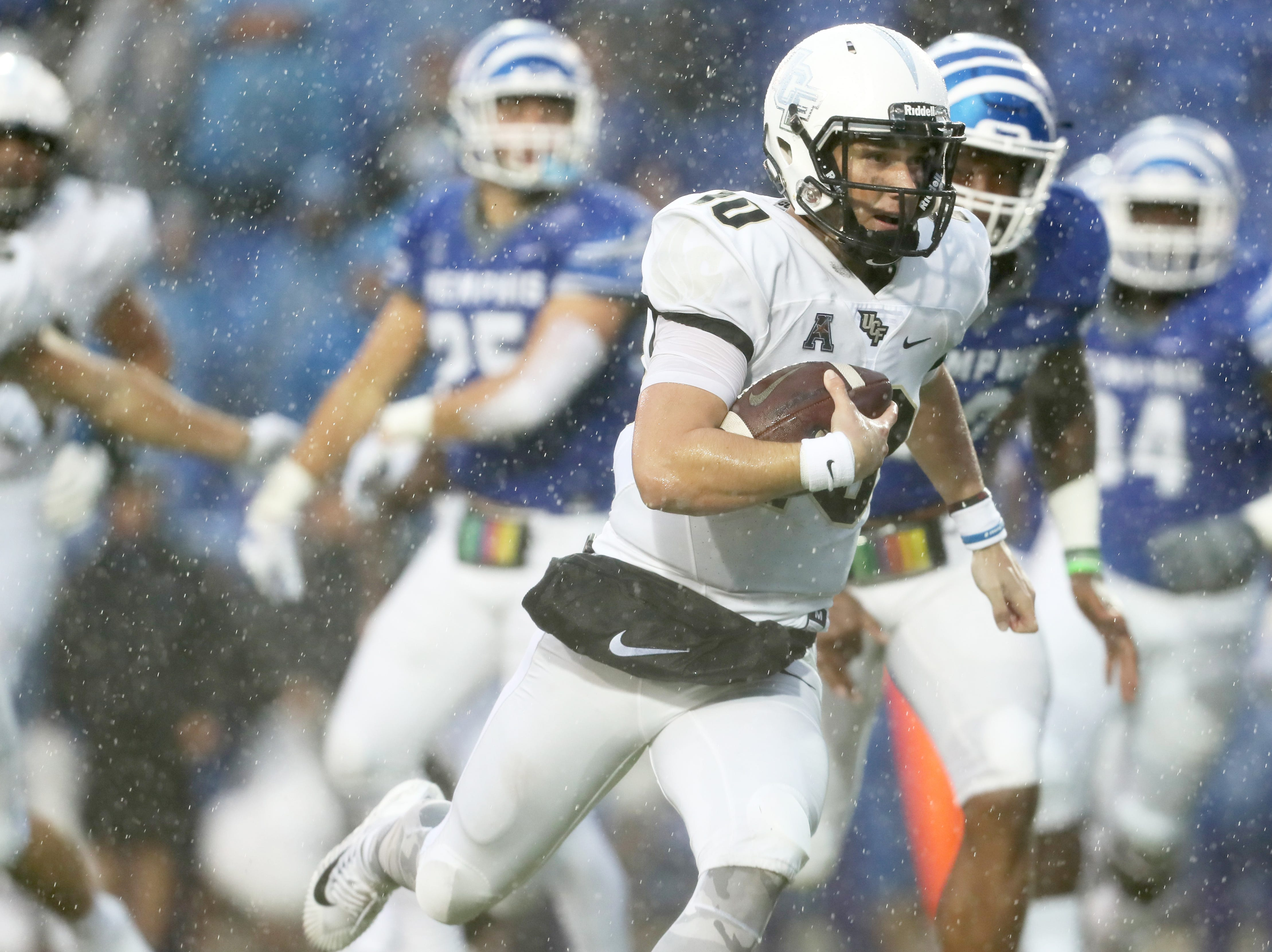 UCF quarterback McKenzie Milton scrambles in for the go-ahead touchdown against Memphis in the Knights' 31-30 win at the Liberty Bowl in Memphis, Tenn., Saturday, October 13, 2018.