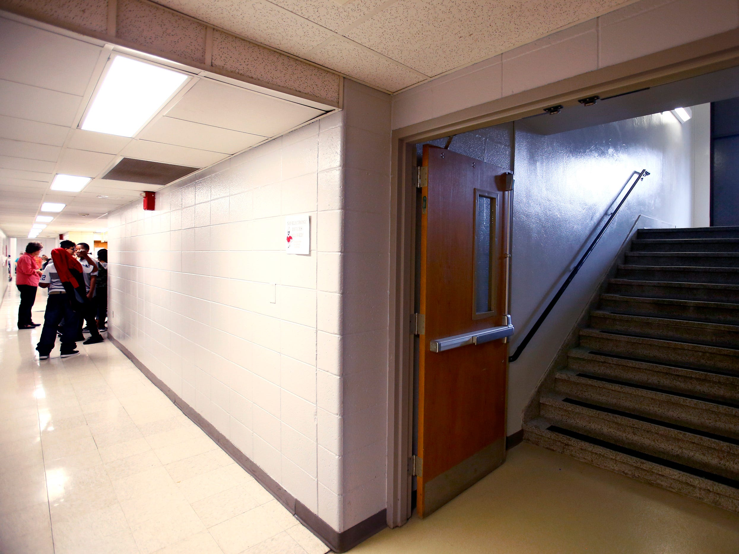 Les Paul students gather in a narrow hallway to the school's cafeteria. The upcoming referendum proposes to improve the cafeteria and its connecting hallways and stairwells.