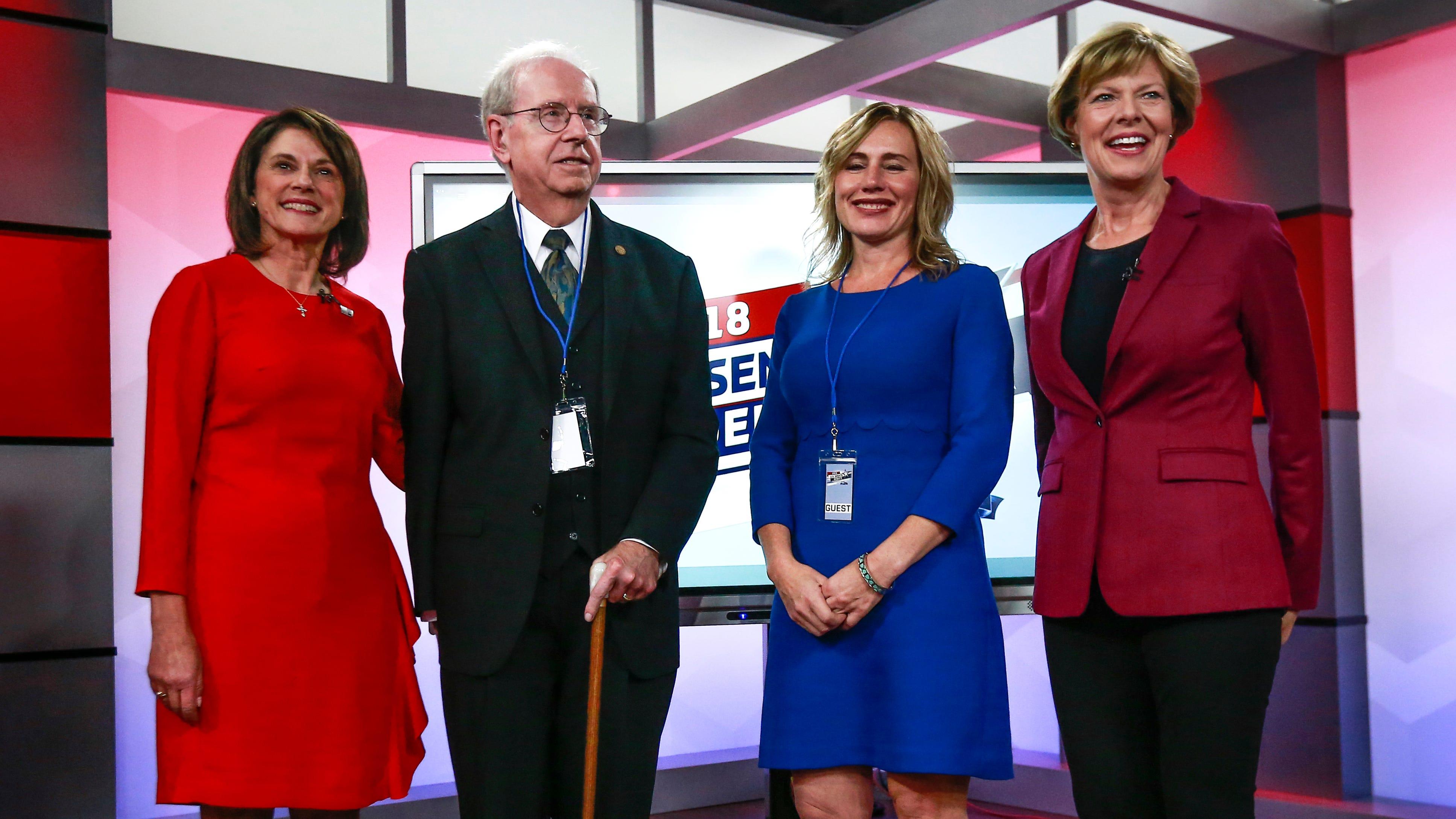 From left, Republican Leah Vukmir, Rolf Wegenke, Rebecca Laron and Democratic U.S. Sen. Tammy Baldwin  pose before Vukmir and Baldwin debated in Wausau  Saturday night, Oct. 13, 2018.