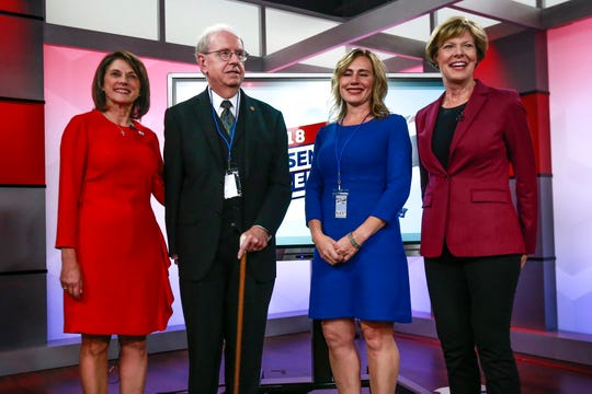 From left, Republican Leah Vukmir, Rolf Wegenke, Rebecca Laron and Democratic U.S. Sen. Tammy Baldwin  pose before Vukmir and Baldwin debated in Wausau  Saturday night, Oct. 13, 2018.
