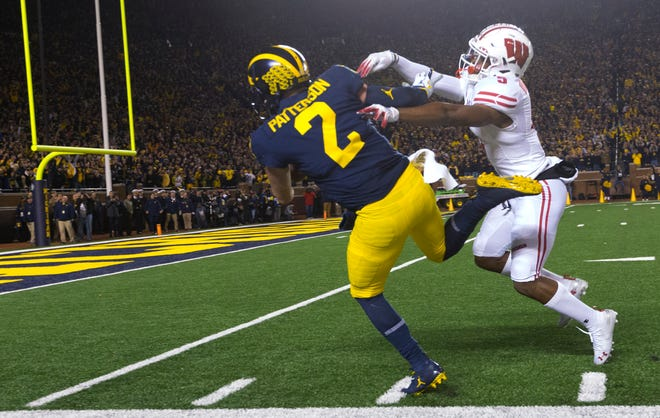 Badgers cornerback Rachad Wildgoose shoves Shea Patterson out of bounds after the Michigan quarterback ripped off an 81-yard run during the first quarter on Saturday night.