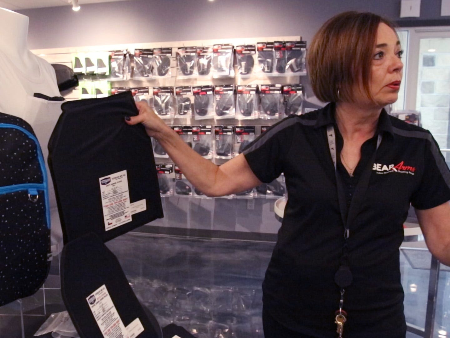Cheryle Rebholz talks about ballistic plates that can be inserted in clothing, a backpack or other apparel that is offered at Bear Arms in Mequon, a boutique indoor shooting range that serves the family market.
