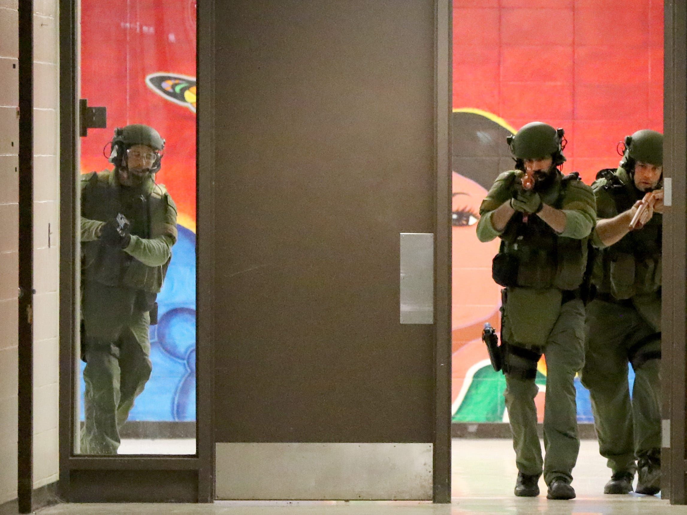 Tactical officers enter the former Plank Road School building at the Milwaukee Regional Medical Center in the initial moments of an active shooter training evolution on Oct. 11 that included personnel from the MRMC campus, Wisconsin Lutheran College and local police and fire departments.