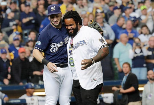 Former teammates Ryan Braun and the retired Prince Fielder share a moment after Fielder threw out the ceremonial first pitch before the Brewers played the Dodgers in Game 2 of the NLCS on Saturday at Miller Park.