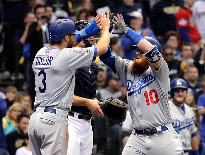 Dodgers third baseman Justin Turner and centerfielder Chris Taylor celebrate after Turner's homer scored Taylor in the eighth inning to put the Dodgers ahead.