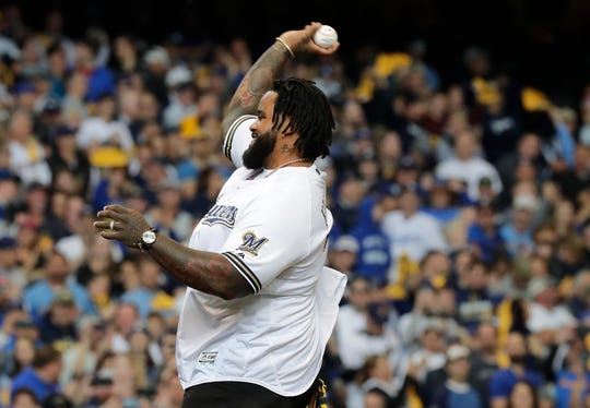 Former Brewers slugger Prince Fielder throws out the first pitch before Game 2 of the NLCS on Saturday afternoon at Miller Park.