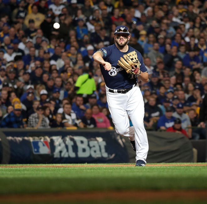 Brewers third baseman Mike Moustakas throws out Matt Kemp of the Dodgers at first base for the first out of the top of the second inning during Game 2 of the NLCS on Saturday.
