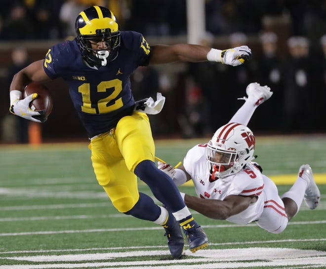 Wisconsin cornerback Rachad Wildgoose  is unable to drag down Michigan running back Chris Evans during the fourth quarter on Saturday night.