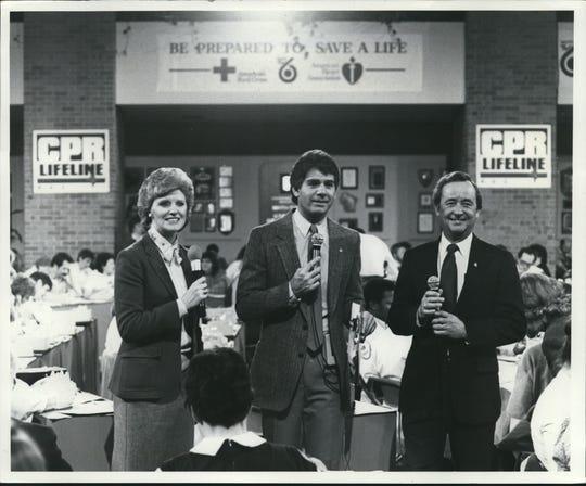 1984 - (From left) TV6's Jill Geisler, Vince Gibbens and Tom Hooper at work on the CPR Lifeline Telethon in Milwaukee.