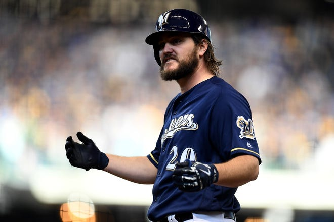 Wade Miley reacts after hitting a single in the fifth inning of Game 2 of the NLCS. Miley had two hits in the game and worked 5 2/3 scoreless innings.