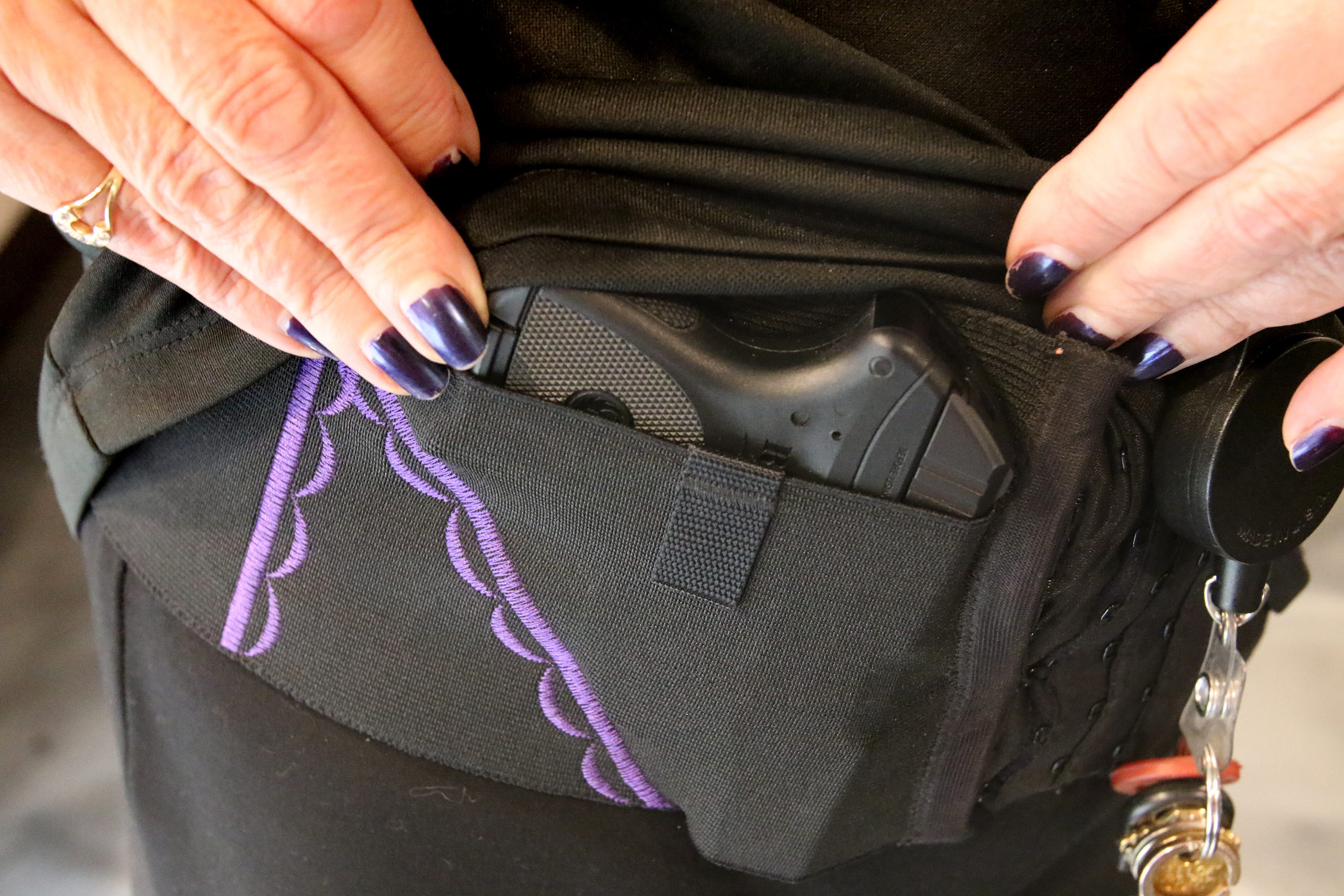 Cheryle Rebholz shows a conceal carry holster made specifically for women and offered at Bear Arms in Mequon, a boutique indoor shooting range that serves the family market.
