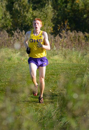 Oconomowoc junior Alexander Vance competes in the boys varsity race at the Classic 8 cross country meet Saturday, October 13, 2018, at Lake Denoon Middle School. He finished second.