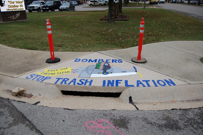 """Mountain Home High School students painted several stormwater runoff drains on Bomber Boulevard last year. The """"Paint the Drain"""" program is one small part of the City of Mountain Home's municipal separate storm sewer system plan."""