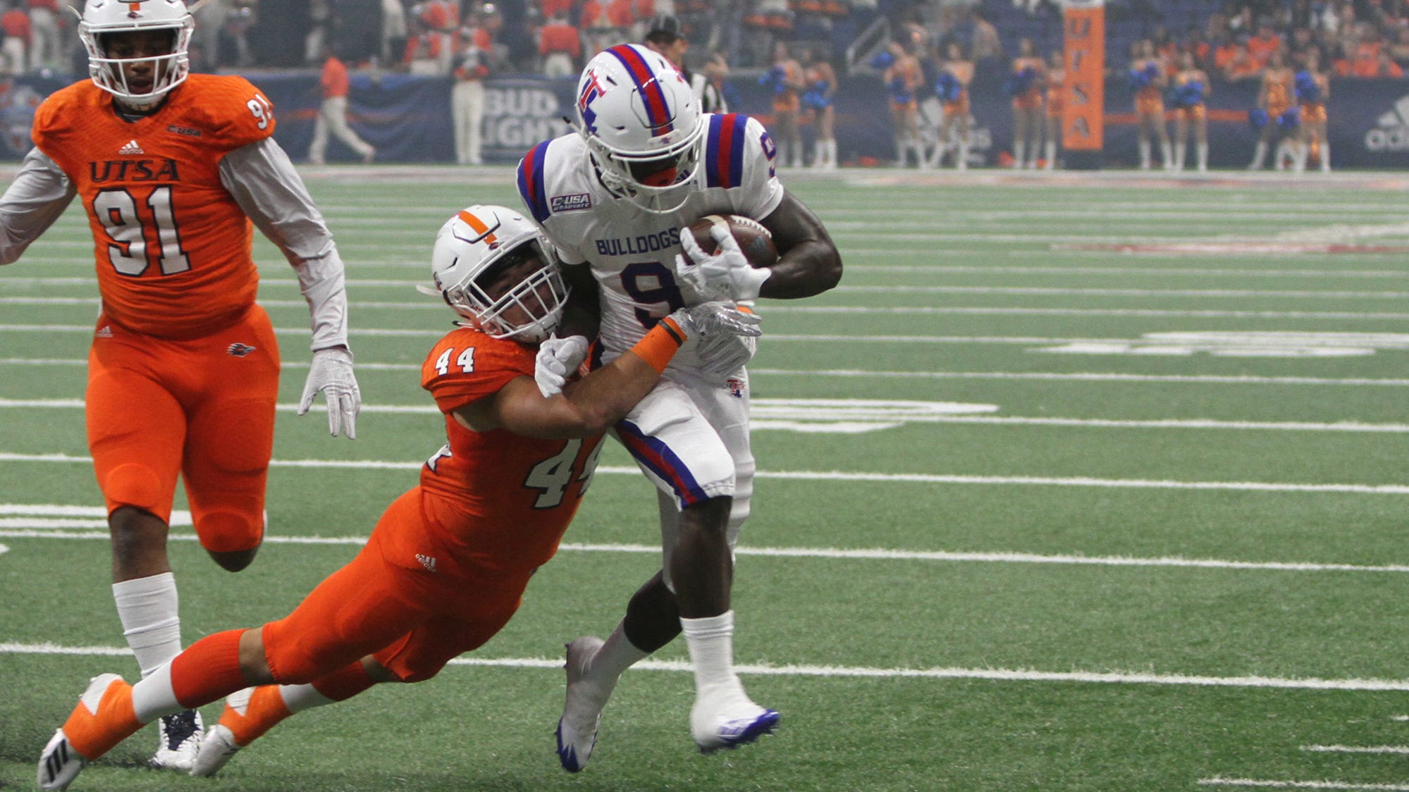 Louisiana Tech senior receiver Teddy Veal (9) fights for extra yardage versus UTSA Saturday, Oct. 13, 2018 at the Alamodome.