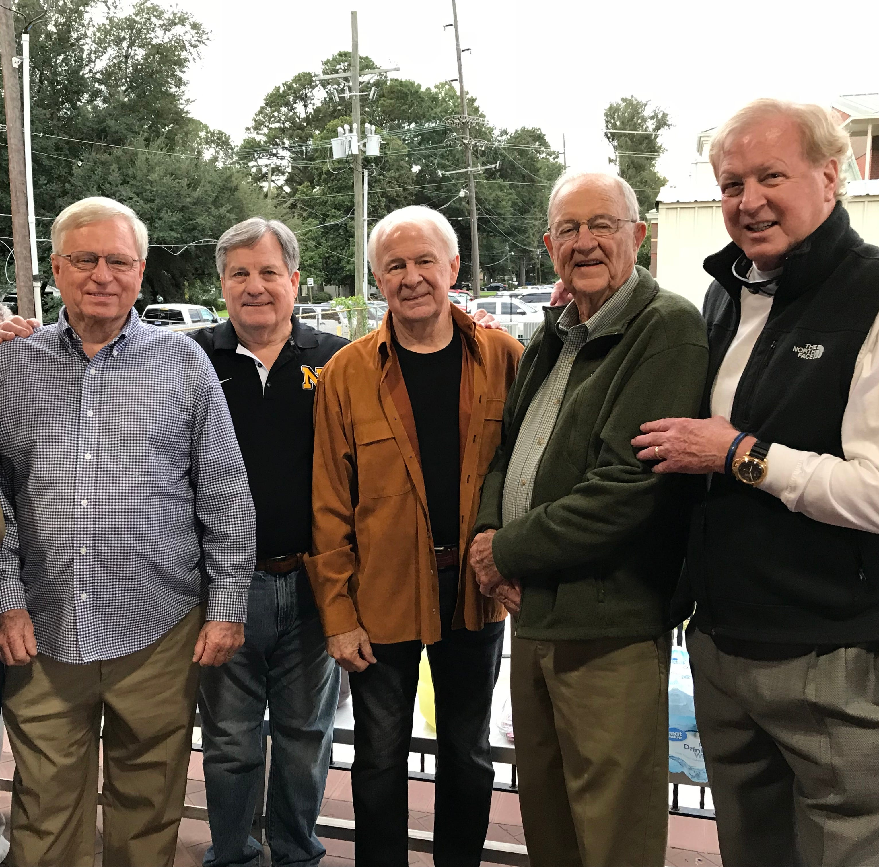 (Left to right) Joe Canal, Don Brown, Steven Jefferson, Jim Howard, Coach George Davis and Bumzy Bryant catch up at Neville's 1962 track and field reunion on Friday at Bill Ruple Stadium.