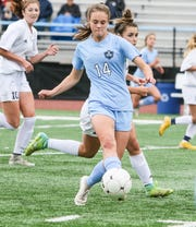 West Morris' Grace Finlay brings the ball up the field against Randolph during a Morris County Tournament girls soccer semifinal at Parsippany Hills High School on October 14, 2018.