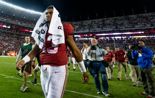 Alabama quarterback Tua Tagovailoa (13) walks off the field after defeating Missouri in second half action at Bryant Denny Stadium in Tuscaloosa, Ala., on Saturday October 13, 2018.
