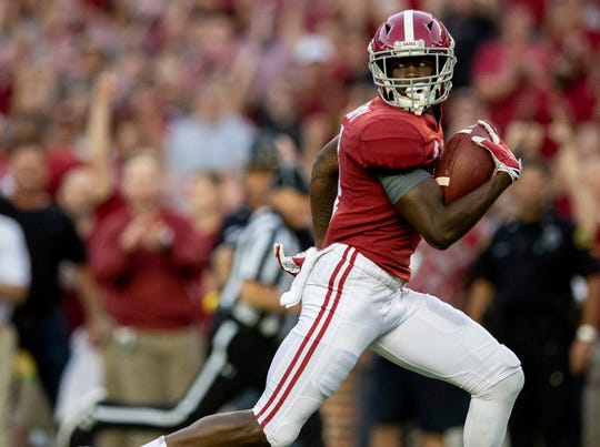 Alabama wide receiver Jerry Jeudy (4) scores on a long touchdown catch against Missouri in first half action at Bryant Denny Stadium in Tuscaloosa, Ala., on Saturday October 13, 2018.