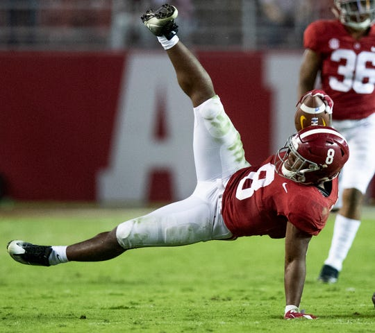 Alabama running back Josh Jacobs (8) is upended against Missouri in second half action at Bryant Denny Stadium in Tuscaloosa, Ala., on Saturday October 13, 2018.