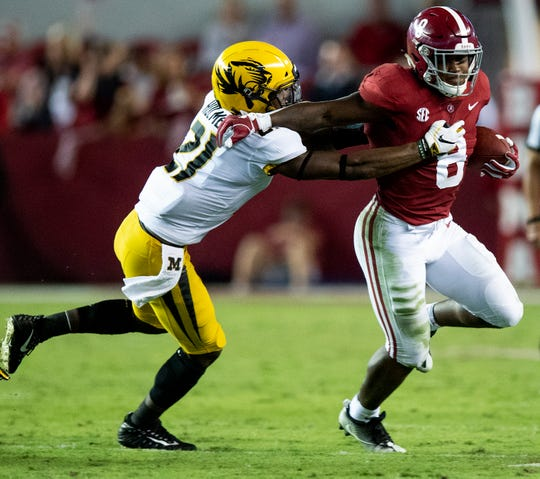 Alabama running back Josh Jacobs (8) tries to shake the tackle of Missouri defensive back Christian Holmes (21) in second half action at Bryant Denny Stadium in Tuscaloosa, Ala., on Saturday October 13, 2018.