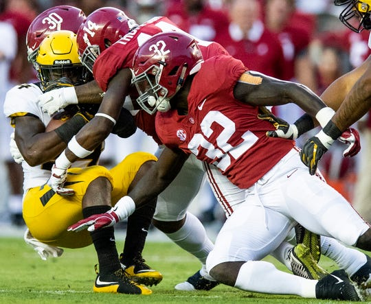 Missouri running back Larry Rountree, III, (34)  is stopped bye Alabama linebacker Mack Wilson (30), defensive back Deionte Thompson (14) and linebacker Dylan Moses (32) in first half action at Bryant Denny Stadium in Tuscaloosa, Ala., on Saturday October 13, 2018.