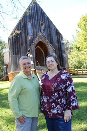 Old Cahawba Site Director Linda Derry, left, and Curator Bruce Lipscombe stand in front of St. Luke's Episcopal Church built in 1854.