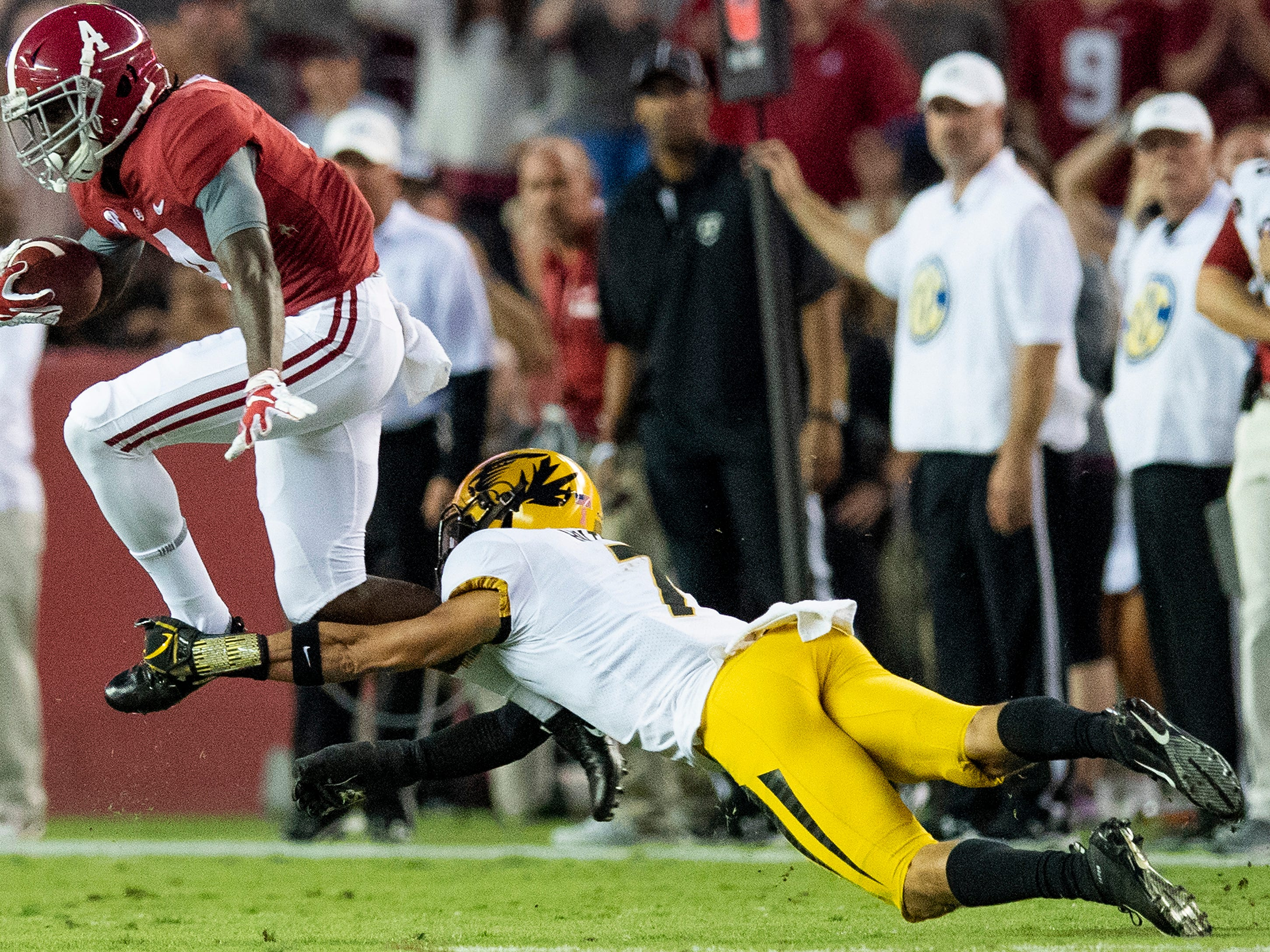 Alabama wide receiver Jerry Jeudy (4) leaps out of the grasp of Missouri safety Cam Hilton (7) in first half action at Bryant Denny Stadium in Tuscaloosa, Ala., on Saturday October 13, 2018.