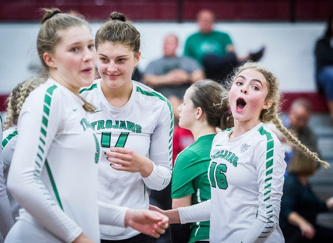 New Castle's Bailey Cox celebrates a point during the sectional championship win over Delta.