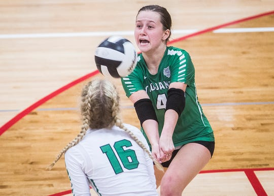 New Castle's Zoe Conway passes against Delta's defense during their sectional championship game at Wapahani High School Saturday, Oct. 13, 2018.