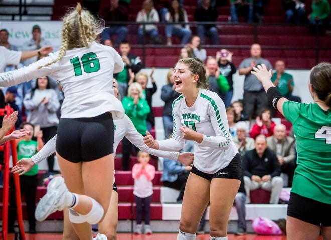 New Castle's Melani Shaffmaster celebrates with her teammates during the sectional championship win over Delta.