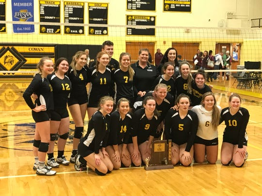 Cowan players pose for photos after winning the sectional championship over Wes-Del.