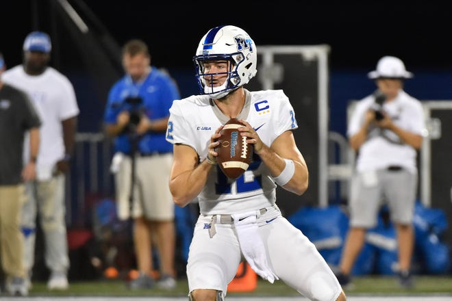MTSU quarteback Brent Stockstill drops back for a pass during the Blue Raiders' game against Florida International on Oct. 13, 2018.