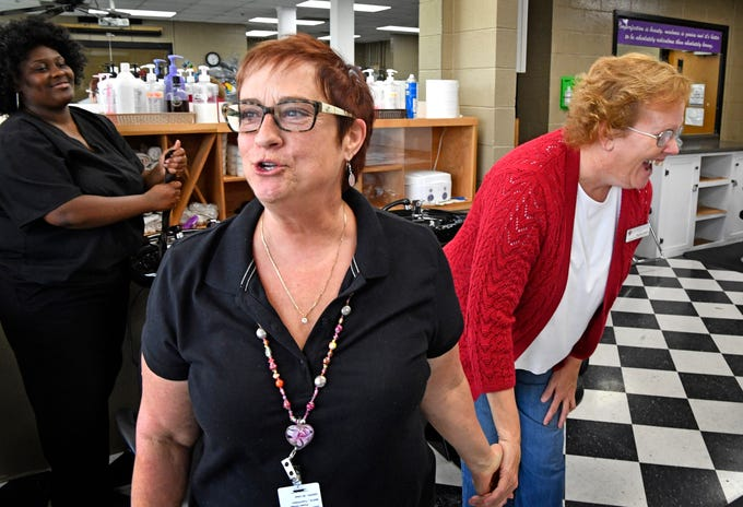 Star Sanford, beautician instructor, embarrasses her friend Charlene Shelton, and talks about what a great person she is. Shelton is a member of Nashville TCAT's team of student services specialists Friday Aug. 17, 2018, in Nashville, Tenn.
