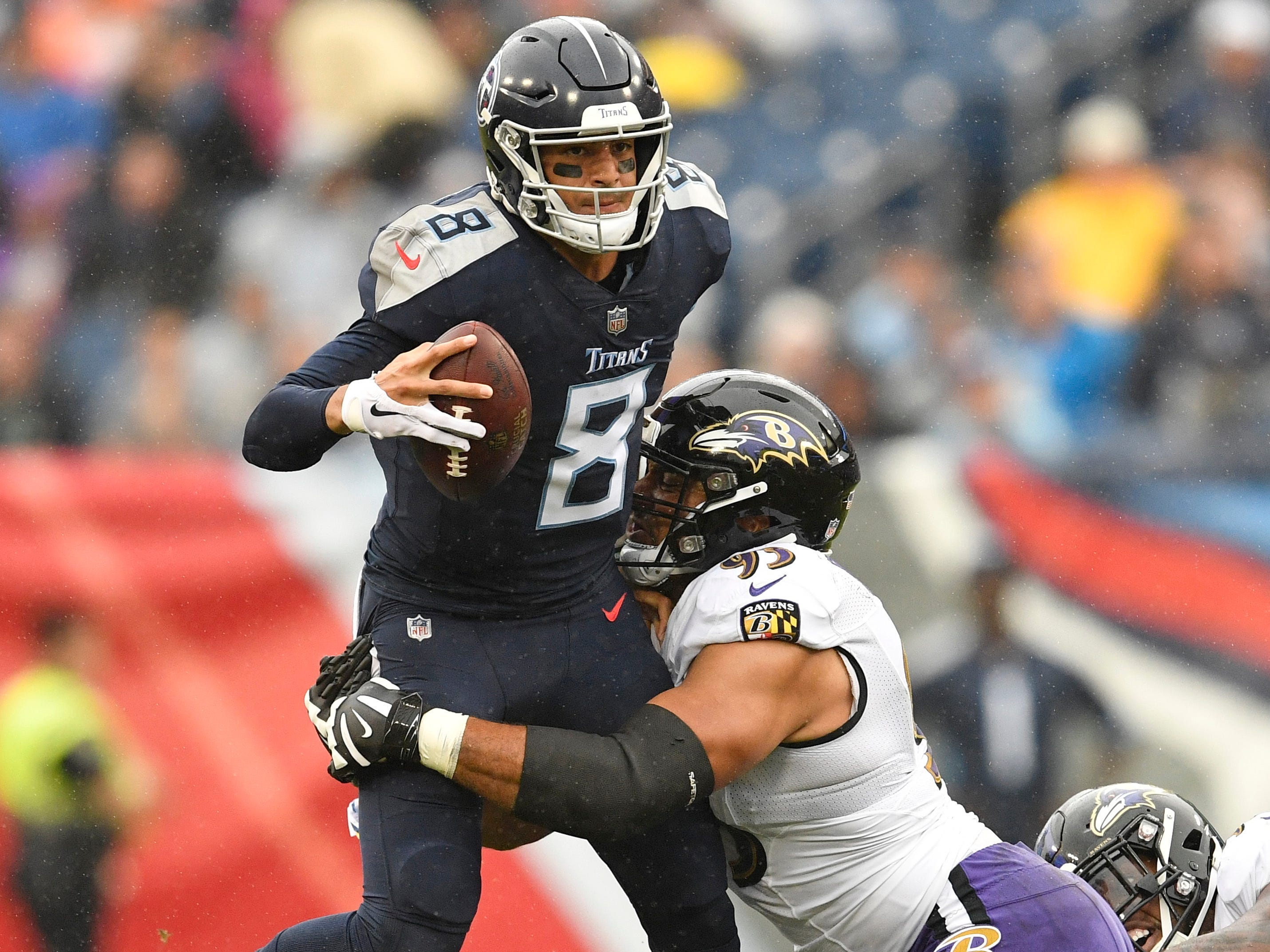 Titans quarterback Marcus Mariota (8) is brought down by Ravens defensive end Chris Wormley (93) in the first quarter at Nissan Stadium Sunday, Oct. 14, 2018, in Nashville, Tenn.