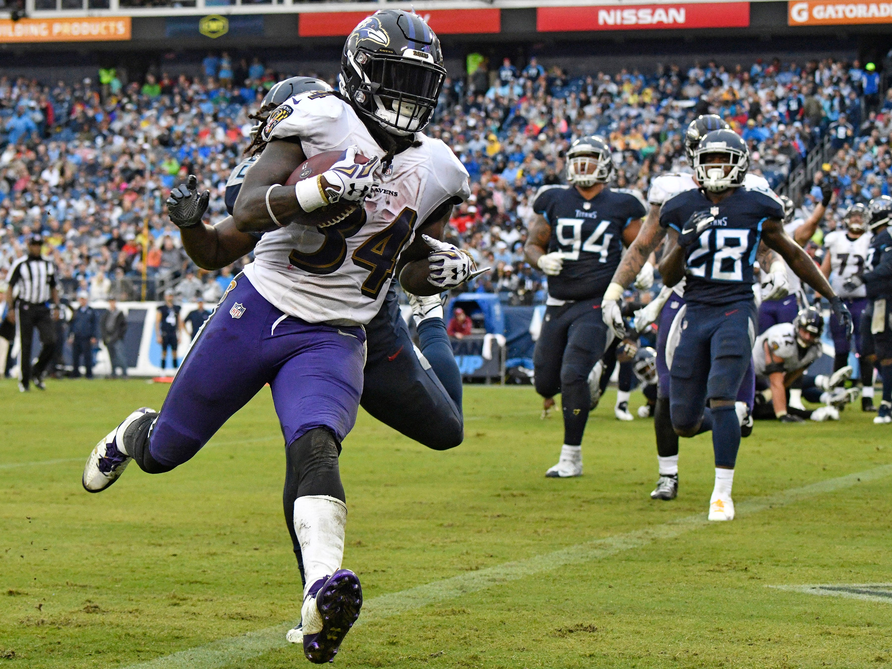 Worst loss runner-up: Ravens 21, Titans 0 (Oct. 14 in Nashville) -- Ravens running back Alex Collins (34) goes in for his second touchdown of the game as the Titans can only watch at Nissan Stadium Sunday, Oct. 14, 2018, in Nashville, Tenn.