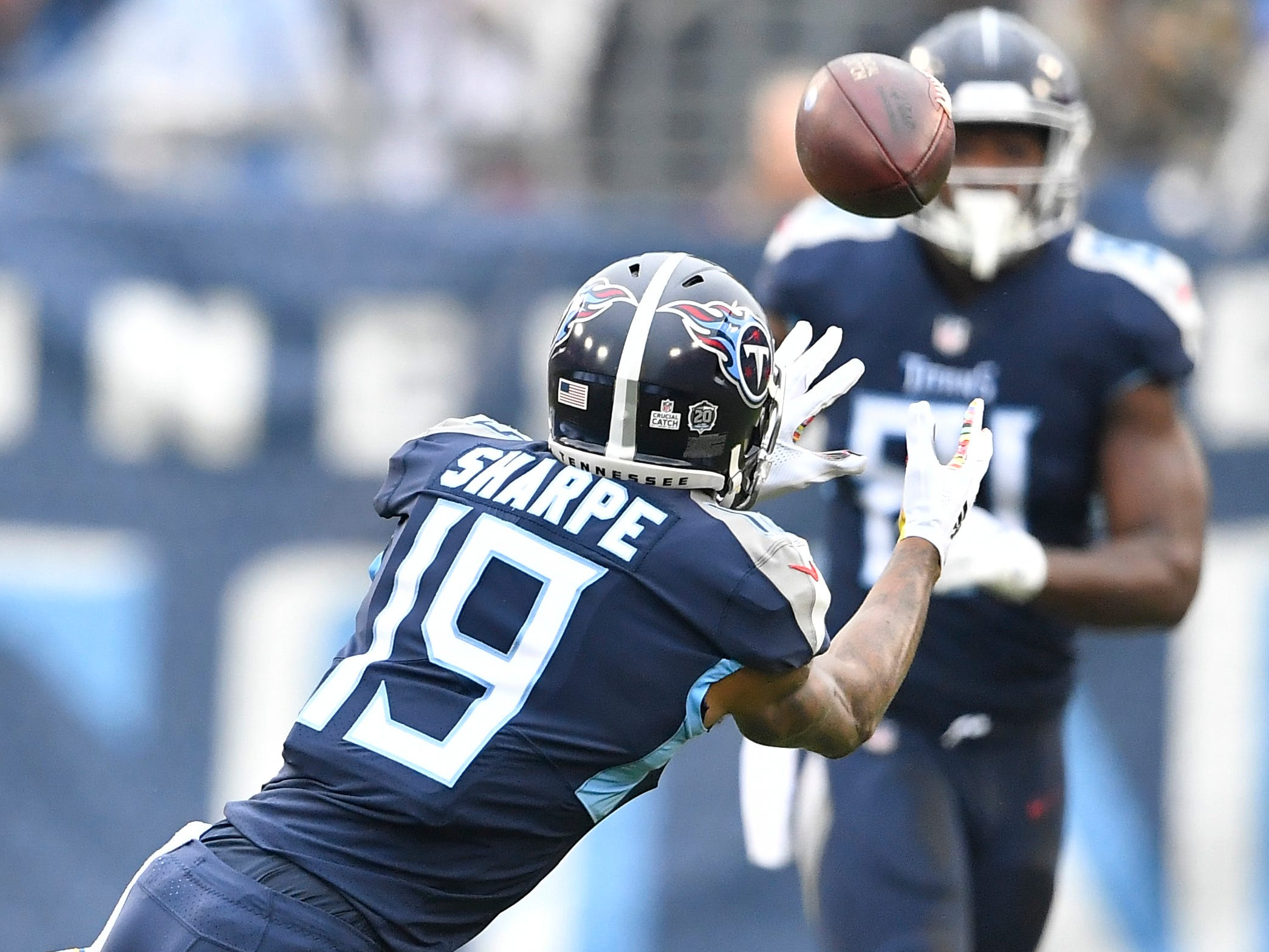Titans wide receiver Tajae Sharpe (19) makes a catch from quarterback Marcus Mariota (8) in the first quarter at Nissan Stadium Sunday, Oct. 14, 2018, in Nashville, Tenn.