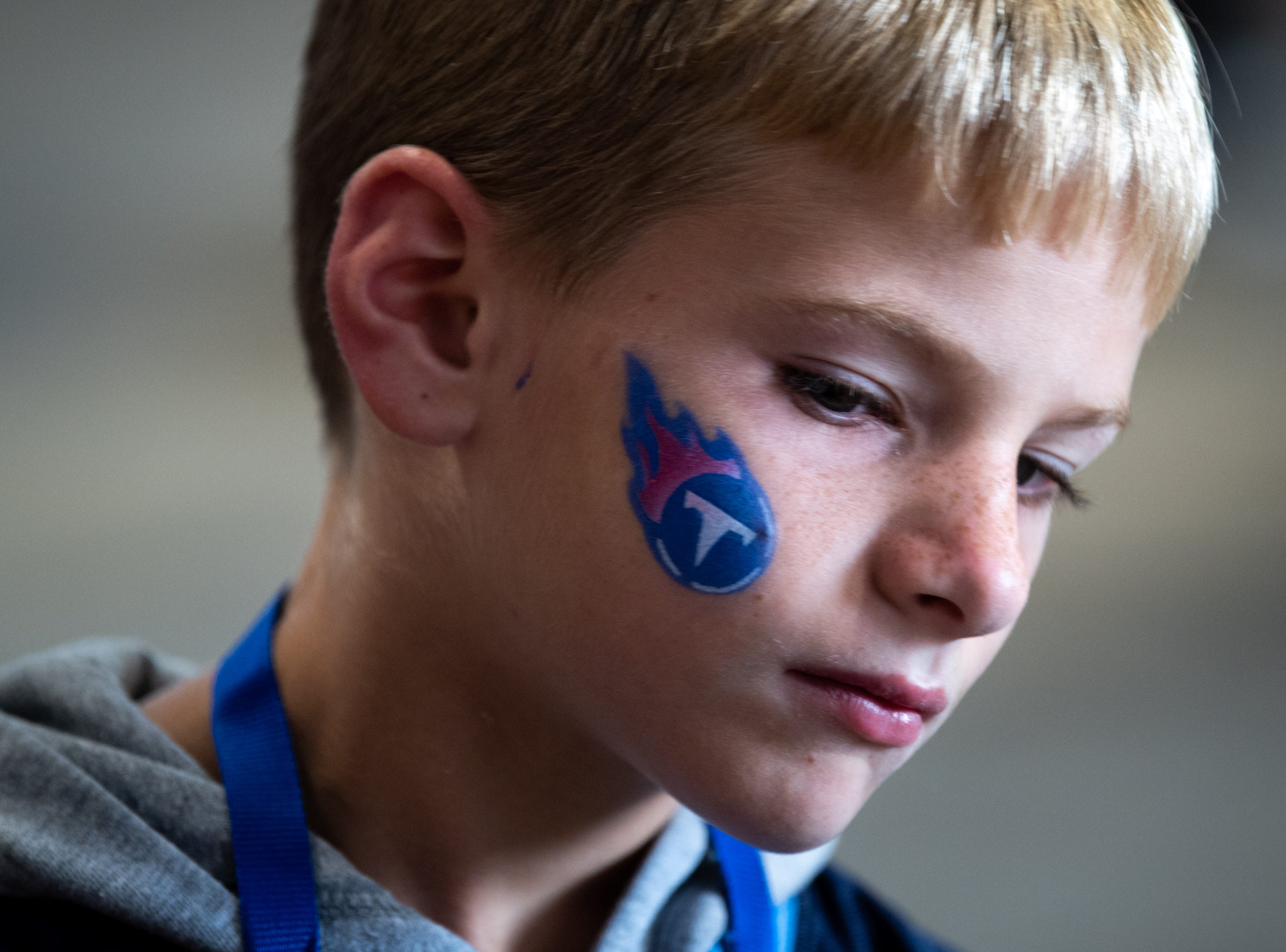 Connor Greene, 7, has his face painted before the game between the Tennessee Titans and the Baltimore Ravens at Nissan Stadium in Nashville, Tenn., Sunday, Oct. 14, 2018.