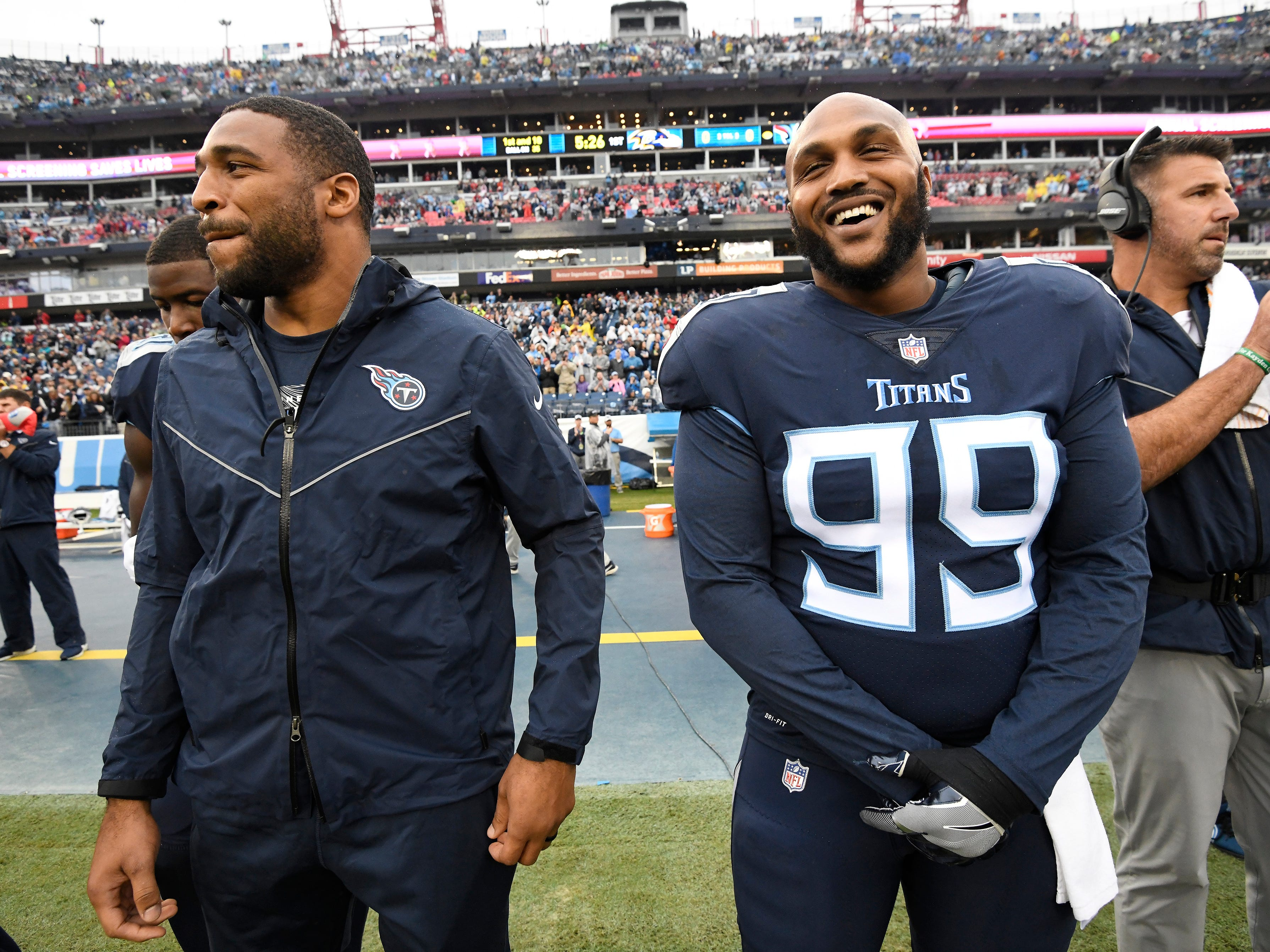 Injured Titans linebacker Wesley Woodyard (59) and defensive tackle Jurrell Casey (99) stand along the sidelines before the game at Nissan Stadium Sunday, Oct. 14, 2018, in Nashville, Tenn.