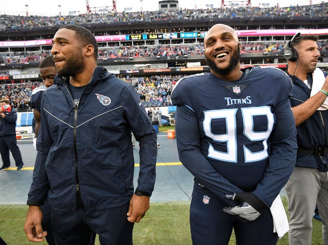 Injured Titans linebacker Wesley Woodyard and defensive tackle Jurrell Casey (99) stand along the sidelines before the game Sunday.