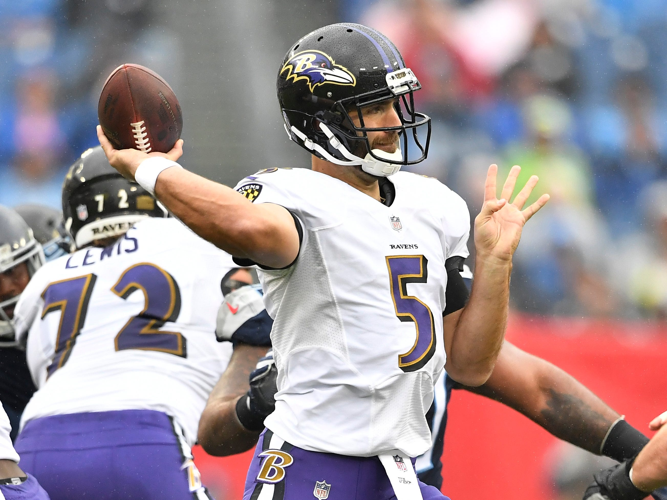 Ravens quarterback Joe Flacco (5) passes in the first quarter against the Titans at Nissan Stadium Sunday, Oct. 14, 2018, in Nashville, Tenn.