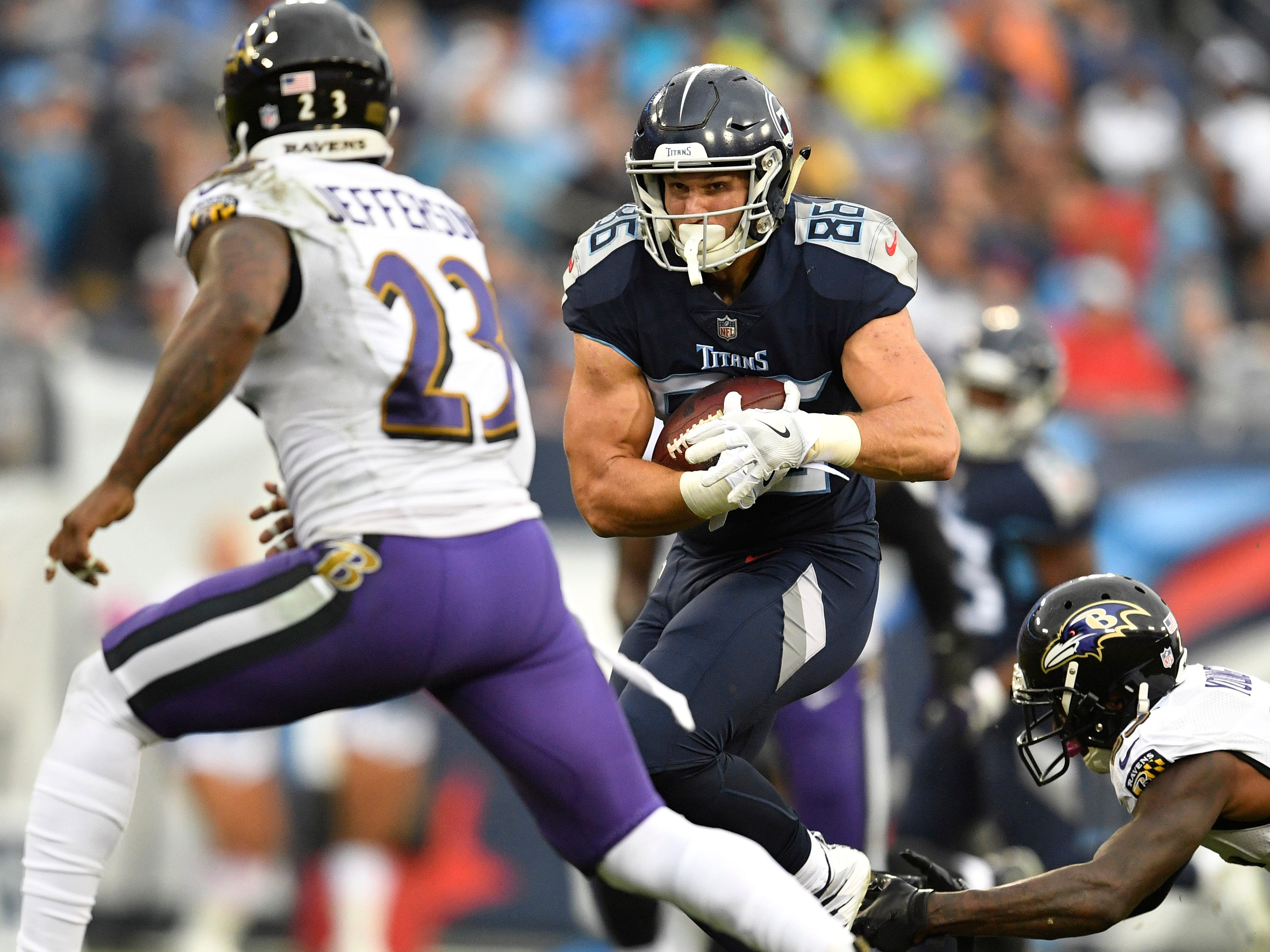 Titans tight end Anthony Firkser (86) tries to gain yards in the second quarter as Ravens strong safety Tony Jefferson (23) closes in at Nissan Stadium Sunday, Oct. 14, 2018, in Nashville, Tenn.