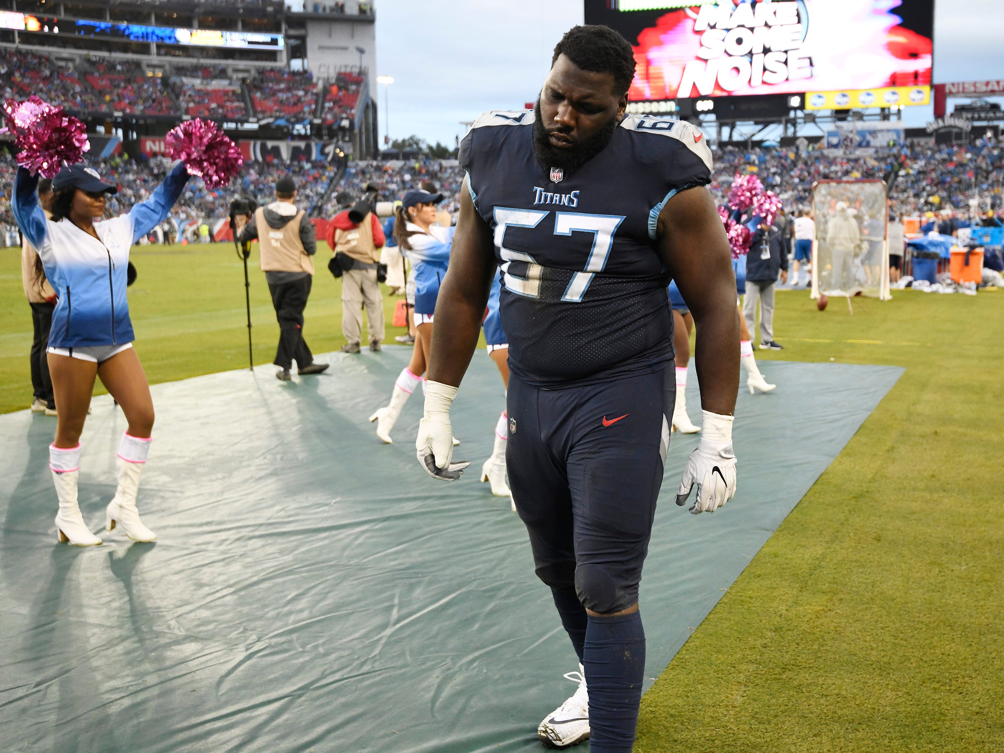 Titans offensive guard Quinton Spain (67) walks off the field after an injury in the second half at Nissan Stadium Sunday, Oct. 14, 2018, in Nashville, Tenn.