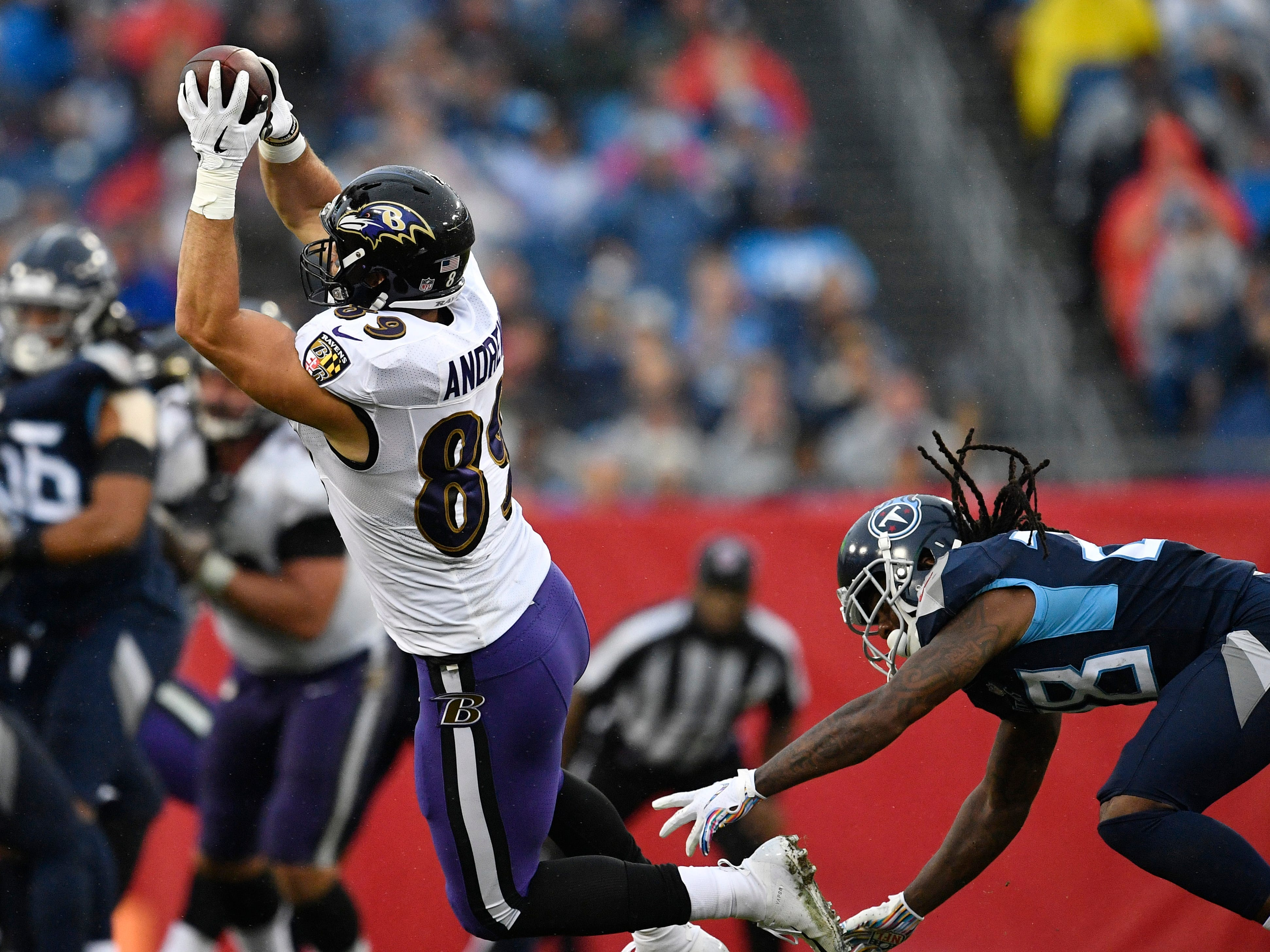 Ravens tight end Mark Andrews (89) hauls in a catch defended by Titans defensive back Kendrick Lewis (28) in the second quarter at Nissan Stadium Sunday, Oct. 14, 2018, in Nashville, Tenn.