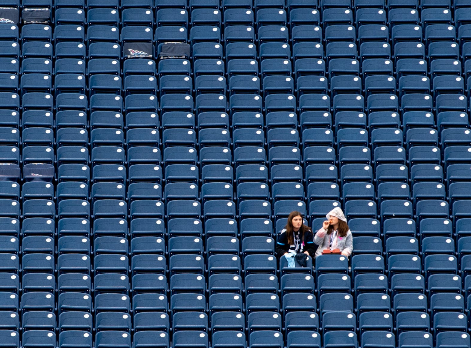 Fans watch warm-ups before the game between the Tennessee Titans and the Baltimore Ravens at Nissan Stadium in Nashville, Tenn., Sunday, Oct. 14, 2018.