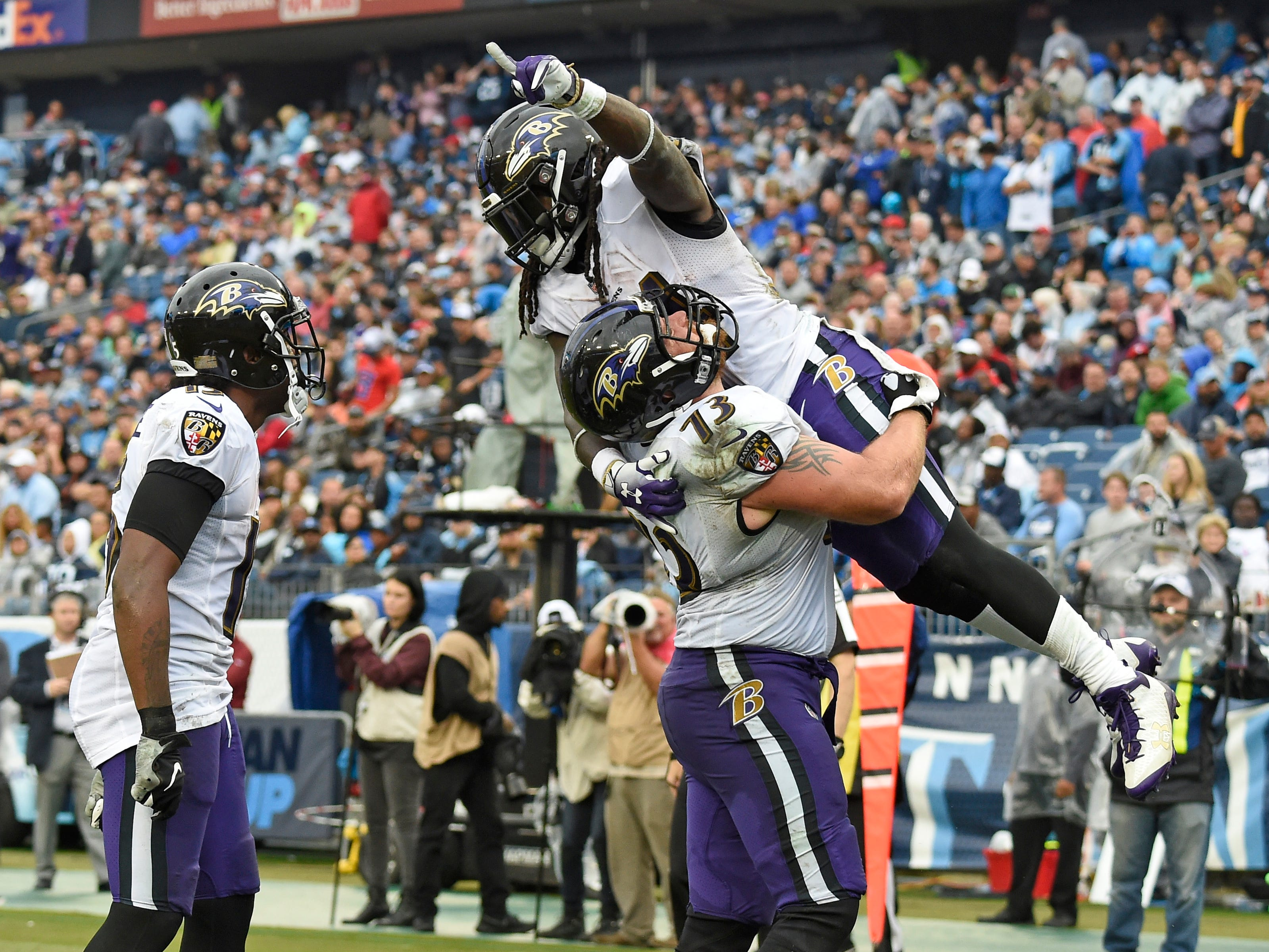 Ravens wide receiver John Brown (13) celebrates his touchdown with Ravens offensive guard Marshal Yanda (73) in the second quarter at Nissan Stadium Sunday, Oct. 14, 2018, in Nashville, Tenn.