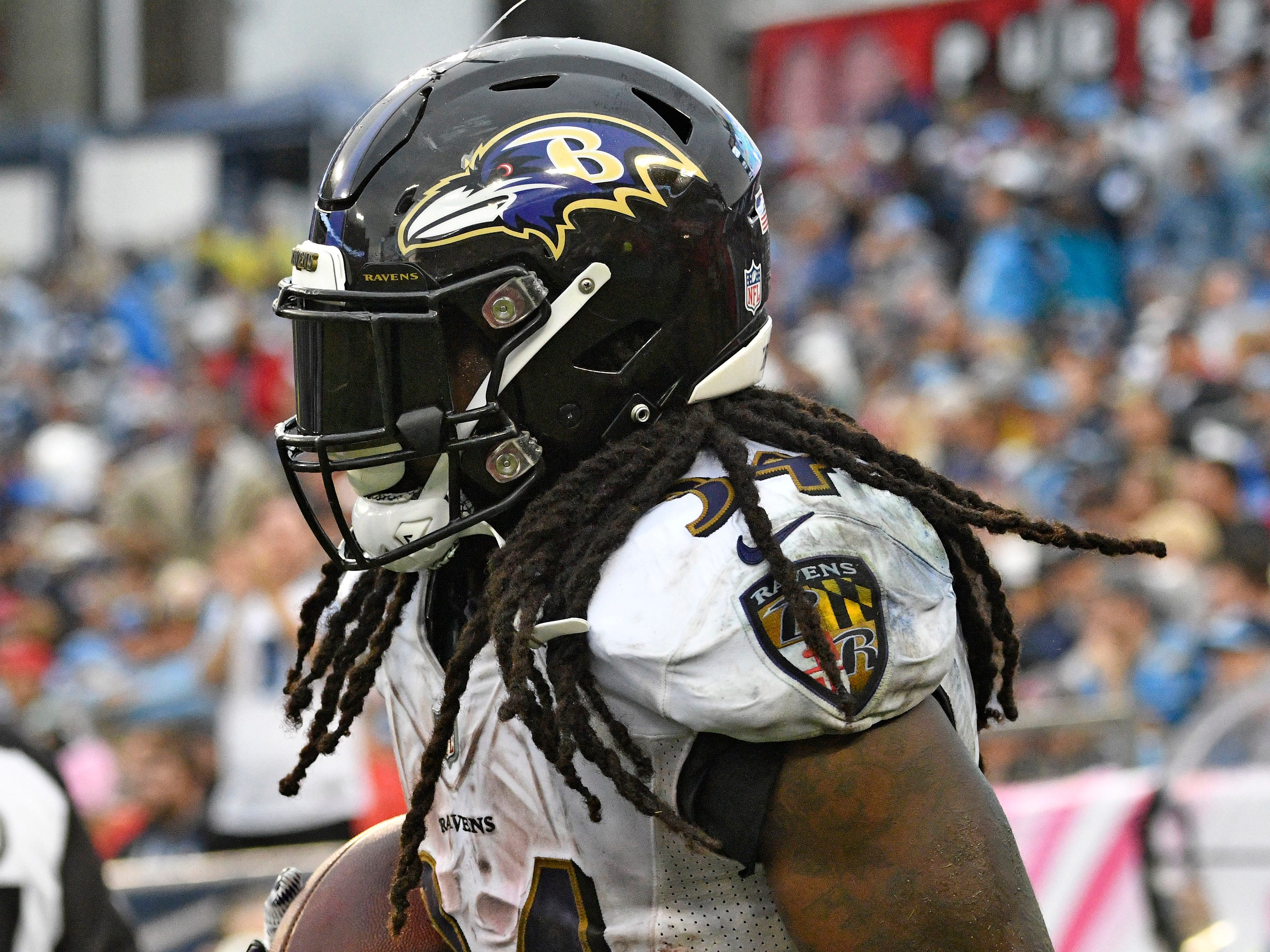 Ravens running back Alex Collins (34) carries the ball after his touchdown in the third quarter at Nissan Stadium Sunday, Oct. 14, 2018, in Nashville, Tenn.