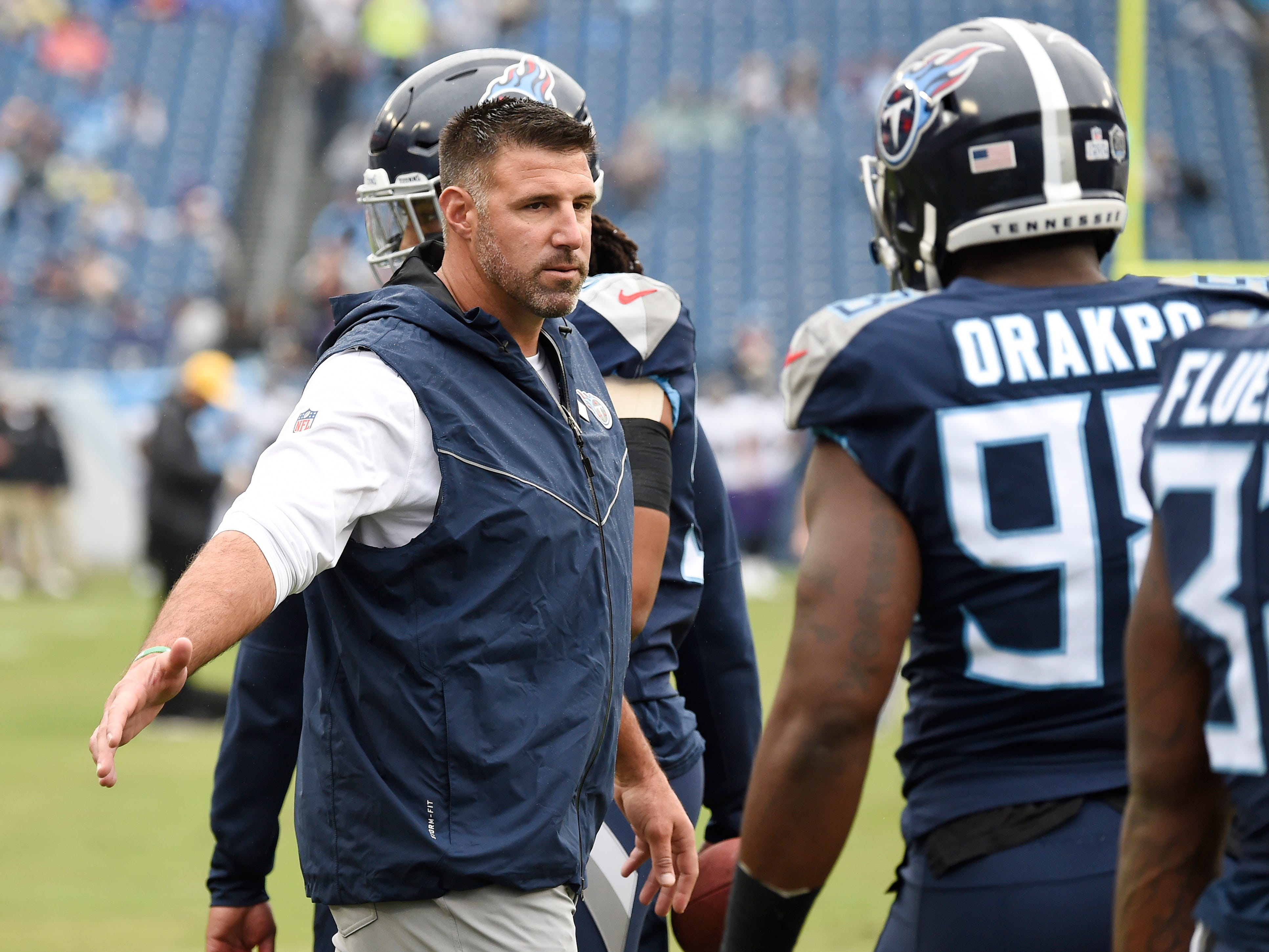 Titans head coach Mike Vrabel slaps hands with linebacker Brian Orakpo (98) before the game at Nissan Stadium Sunday, Oct. 14, 2018, in Nashville, Tenn.