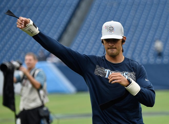 Titans quarterback Marcus Mariota (8) warms up before the game against the Ravens at Nissan Stadium Sunday, Oct. 14, 2018, in Nashville, Tenn.