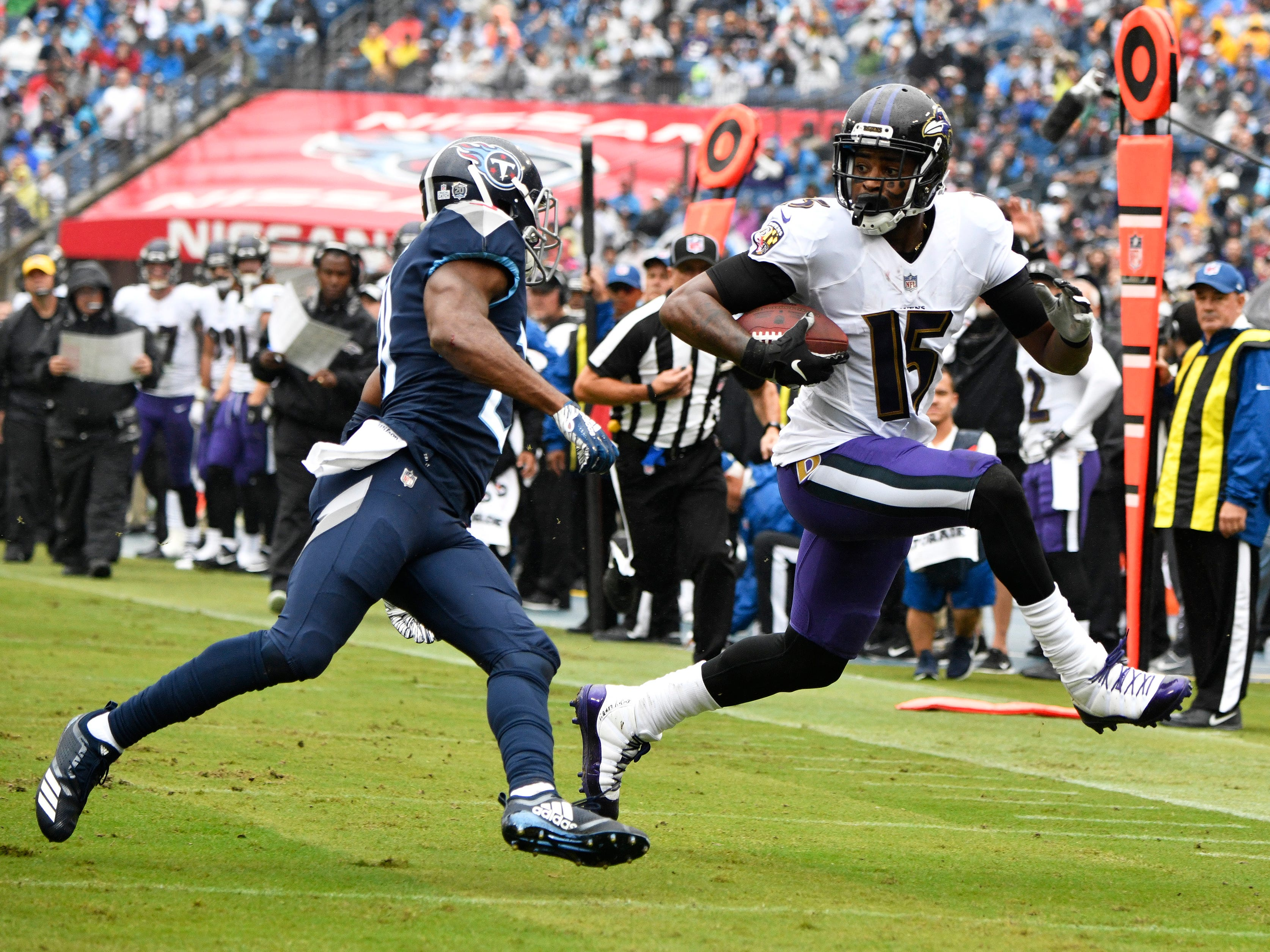 Ravens wide receiver Michael Crabtree (15) gains yards defended by Titans cornerback Malcolm Butler (21) in the first half at Nissan Stadium Sunday, Oct. 14, 2018, in Nashville, Tenn.